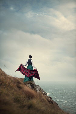 Magdalena Russocka historical scottish woman standing on cliff