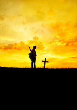 Stephen Mulcahey A silhouette ww1 soldier  standing near a grave