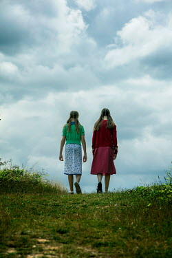 Stephen Mulcahey Two  teenage girls walking up a hill