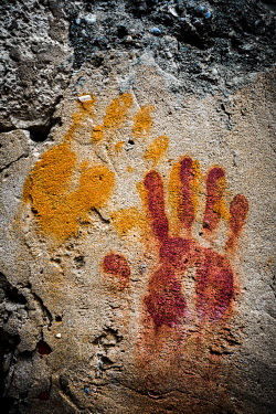 Des Panteva RED AND YELLOW HANDPRINTS ON STONE Miscellaneous Objects