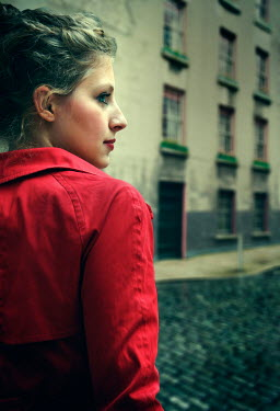 Ute Klaphake Young woman in red jacket on city street