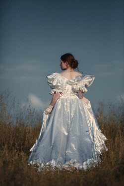 Magdalena Russocka woman in white dress standing in field