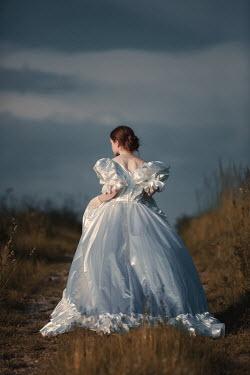 Magdalena Russocka woman in white dress walking in field