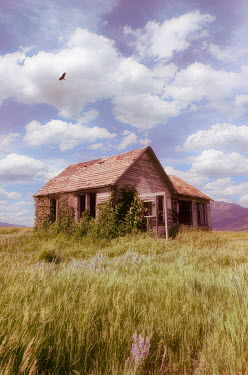 Jill Battaglia Abandoned house under clouds