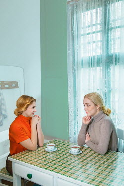 Joanna Czogala Women sitting at kitchen table with tea