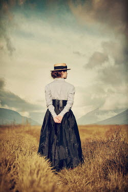 Magdalena Russocka historical woman standing in field with mountains
