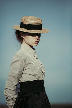 Magdalena Russocka historical woman wearing straw hat outside