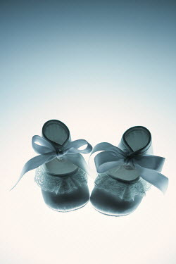 Magdalena Russocka pair of white satin baby shoes