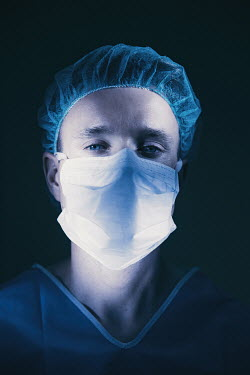 Natasza Fiedotjew close up of male surgeon in mask and uniform