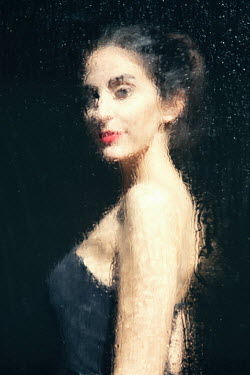 Natasza Fiedotjew young woman in evening dress smiling behind wet window