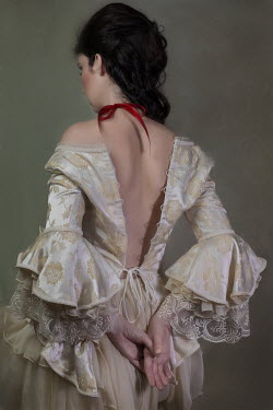 Beata Banach Young woman in vintage dress with red ribbon around neck