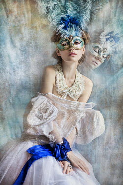 Beata Banach Young woman in blue masquerade mask