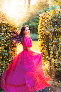 Lee Avison victorian woman running in the garden at sunset