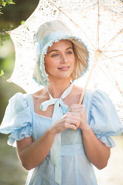 Lee Avison regency woman  powder blue empire line dress and parasol