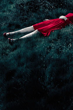 Magdalena Russocka dead body of woman in red dress lying in grass