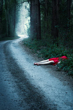 Magdalena Russocka dead body of woman in red dress lying in forest