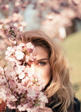 Nina Masic Young woman and pink flowers on branches