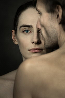 Magdalena Russocka serious woman looking over naked male shoulder