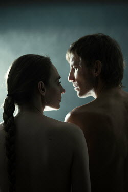 Magdalena Russocka shadowed unhappy naked couple looking at each other