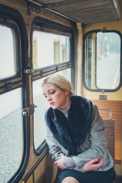 Joanna Czogala Sad woman sitting on train