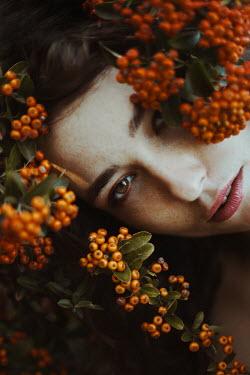 Greta Larosa Young woman amongst berries on tree