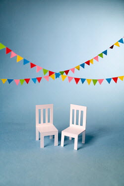 Peter Chadwick Paper craft chairs under party pennant