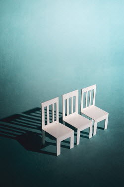 Peter Chadwick Paper craft chairs on blue background