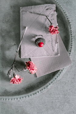 Magdalena Wasiczek silver ring with red coral, old letter and flowers