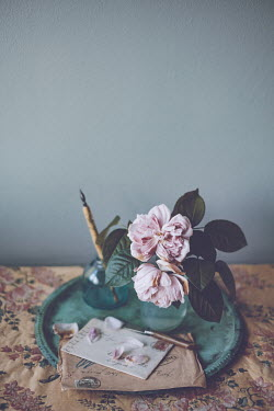 Magdalena Wasiczek pink roses on the table with floral tablecloth in vintage style