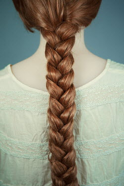 Magdalena Russocka close up of young woman with long braid from behind