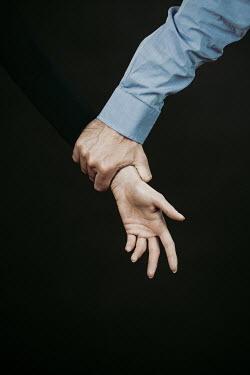 Magdalena Russocka male hand holding female hand