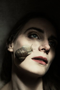 Magdalena Russocka woman with snail on face