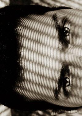 Giovan Battista D'Achille Man under shadow of net