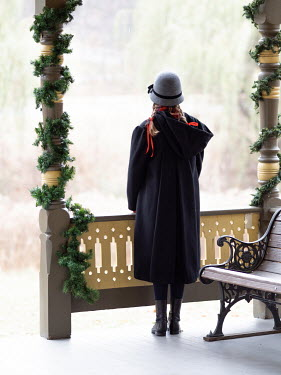 Elisabeth Ansley GIRL IN HAT AND SCARF ON VERANDA AT CHRISTMAS Children
