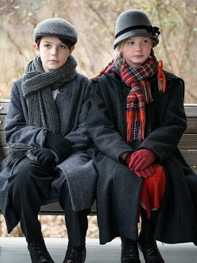 Elisabeth Ansley SERIOUS BOY AND GIRL ON BENCH OUTDOORS Children