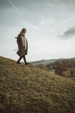 Shelley Richmond WOMAN WALKING DOWN HILL IN AUTUMN Women