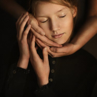 Magdalena Kolakowska Hands touching face of teenage girl