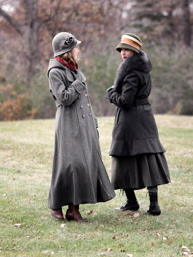 Elisabeth Ansley Young women with vintage hats and coats in park