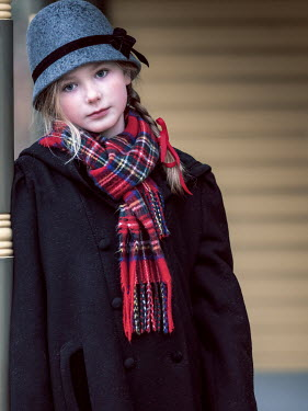 Elisabeth Ansley Teenage girl in vintage cloche hat, scarf, and coat
