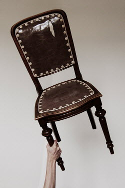 Giovan Battista D'Achille Arm of man holding antique leather chair