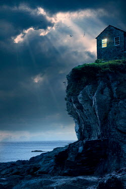 Lee Avison house on a sea cliff at night in storm