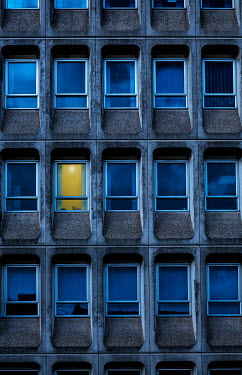 Maggie McCall Light in window of apartment building at night