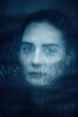 Magdalena Russocka woman behind wet window