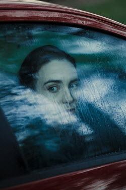 Magdalena Russocka woman behind wet car window