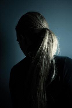 Magdalena Russocka sad modern woman leaning against black wall
