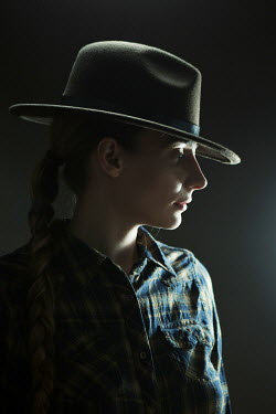 Magdalena Russocka woman wearing cowboy hat in dark room