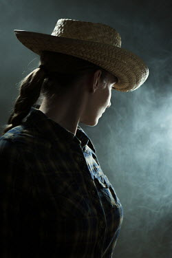 Magdalena Russocka woman in cowboy hat in smoky room