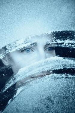 Magdalena Russocka woman behind snowy window