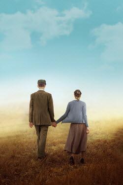 Ildiko Neer Vintage couple walking in field