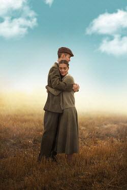 Ildiko Neer Vintage couple embracing in field